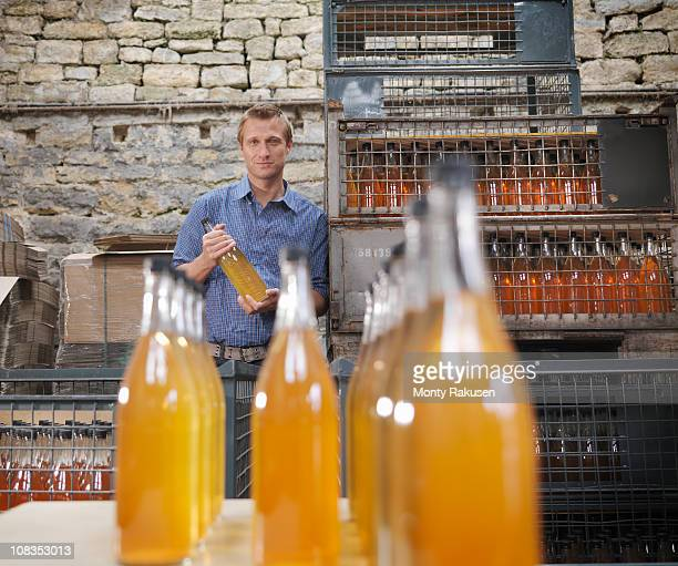 Man with bottles of organic cider