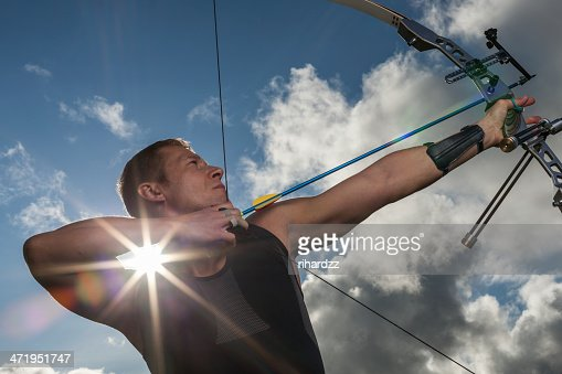 Man with bow and arrows : Stock Photo