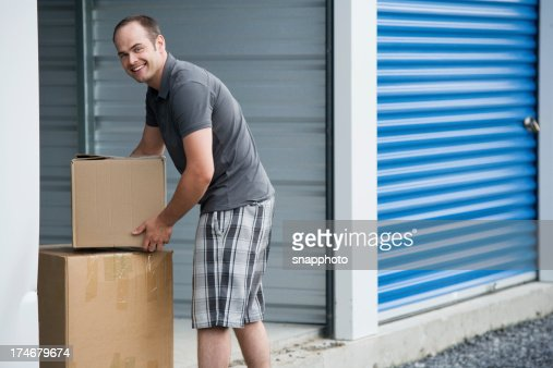 Man with Boxes Outside Self Storage Unit Lifestyle