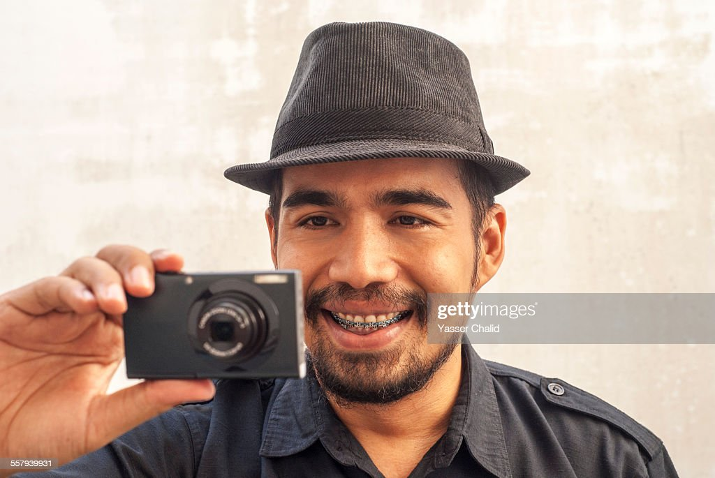 Man with braces and Camera