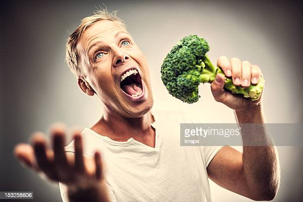 Man with broccoli singing