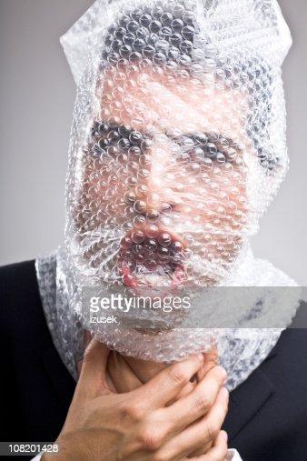 Man with bubble wrap around his head : Stock Photo