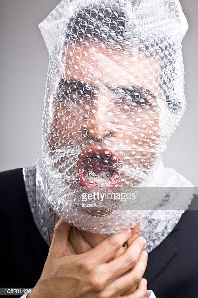 Man with bubble wrap around his head