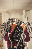 Man with Bundle of Wiring