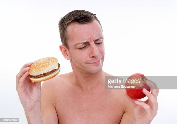 Man with burger and apple