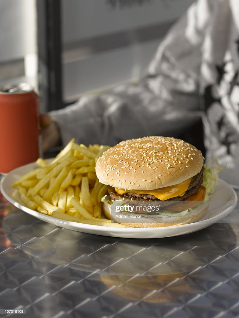 Man with Cafe with Burger : Stock Photo