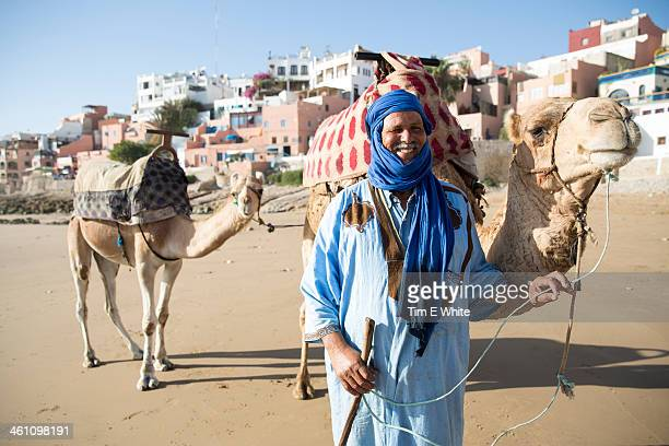 Man with camel on beach, Taghazout, Morocco
