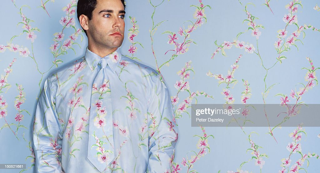 Man with camouflage shirt and tie : Stock Photo