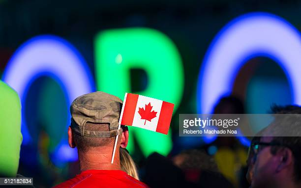 SQUARE TORONTO ONTARIO CANADA Man with Canadian flag People gathered for the Closing Ceremony of the Pan American Games