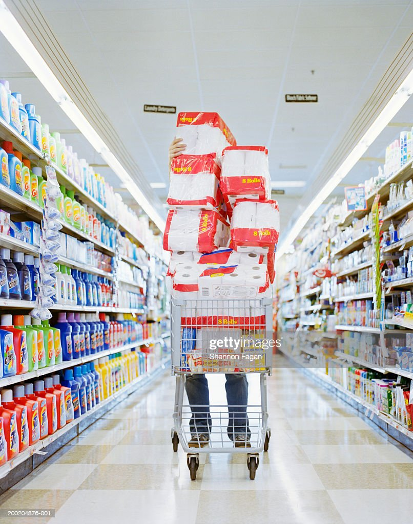 Man with cart stacked with grocery : Stock Photo