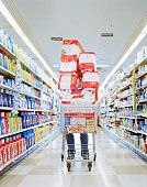 Man with cart stacked with grocery