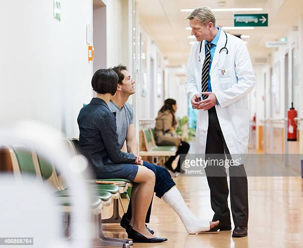 Man With Cast On Broken Leg Consulting Doctor