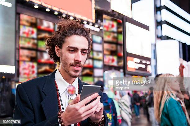 Man with cell phone in New York City.