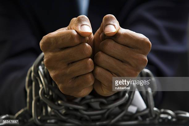 Man with chains around wrists