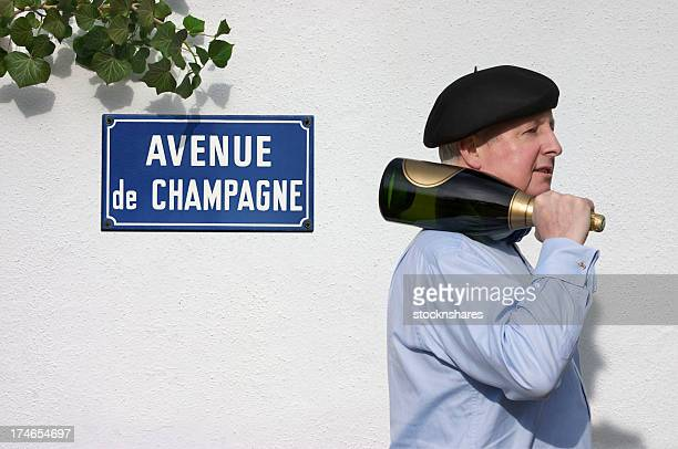 Man with Champagne passing sign saying Avenue de Champagne