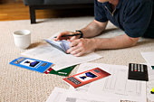 Man with checkbook and paperwork