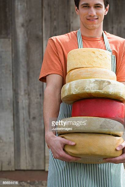 Man with cheese wheels
