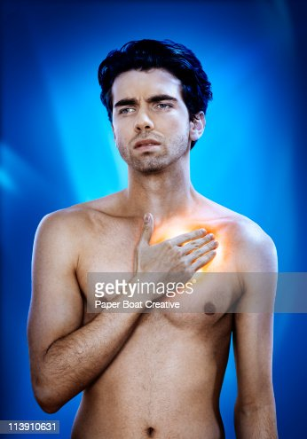 Man with chest pain, glowing in red and yellow : Stock Photo