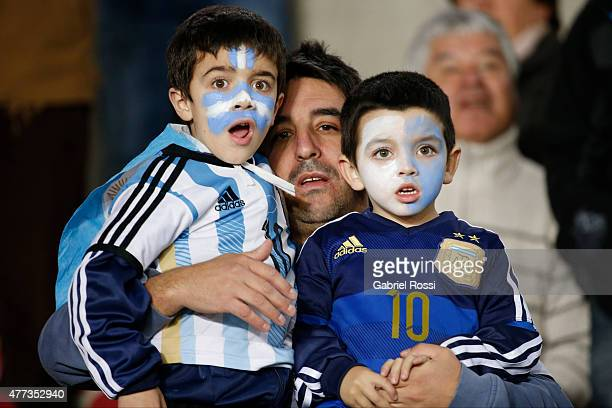 A man with children fans of Argentina enjoys the atmosphere prior the 2015 Copa America Chile Group B match between Argentina and Uruguay at La...