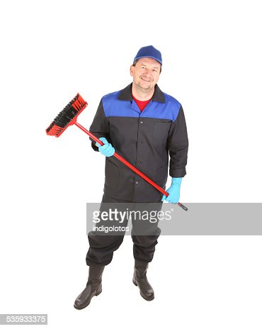 Man with cleaning broom. : Stock Photo