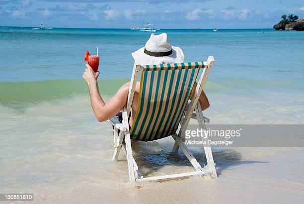 Man with cocktail at seashore