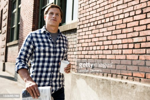 A man with coffee and the newspaper. : Stock Photo