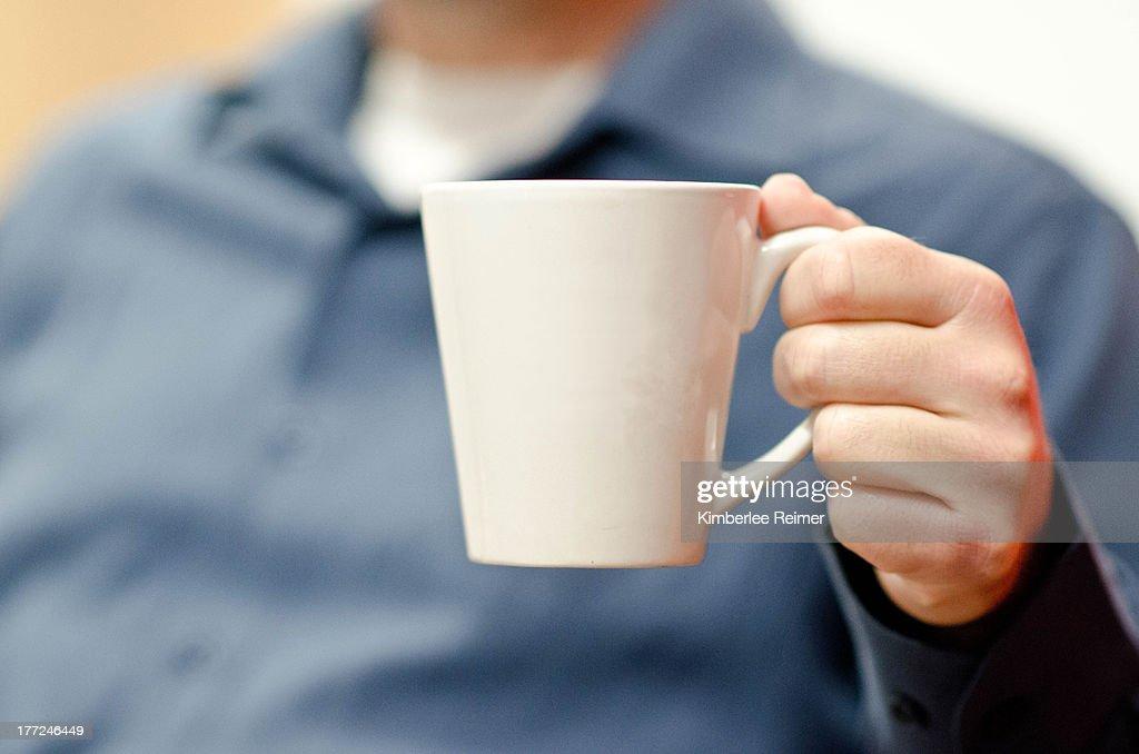 Man with coffee mug