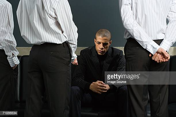 Man with colleagues standing around him