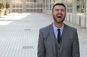 Man with contagious laughter isolated.