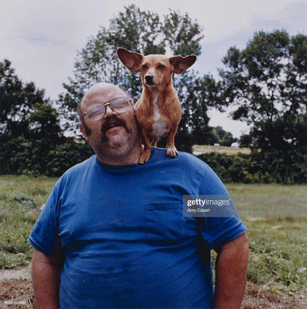 Man with Corgi on Shoulder : Stock Photo