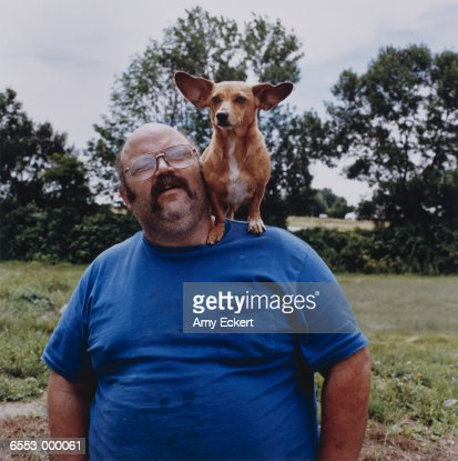 Man with Corgi on Shoulder : Stock Photo