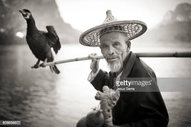 Man with cormorant, Yangshuo, Guangxi, China