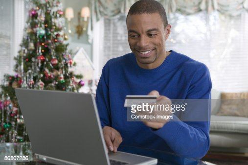 Man with credit card and laptop computer : Stock Photo