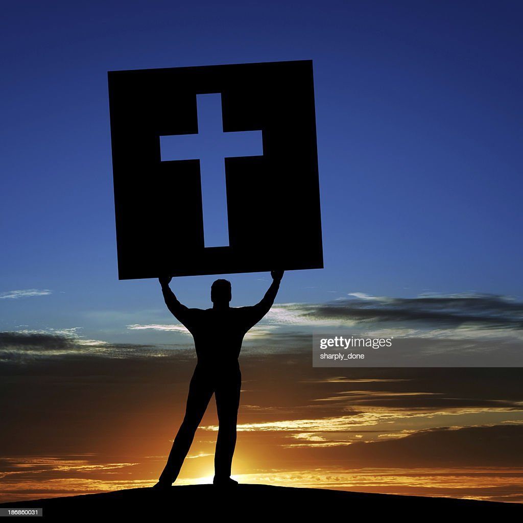 XL man with cross sign