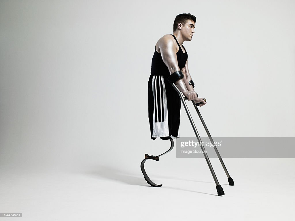 Man with crutches and prosthetic leg