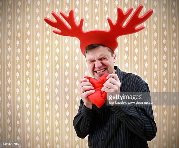 Man with deer horn hat