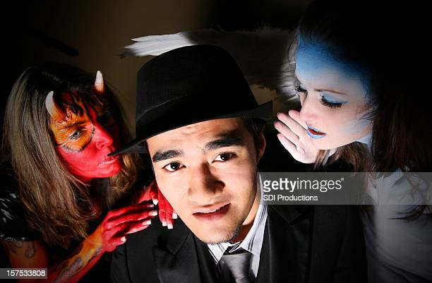 Man with devil and angel telling him what to do