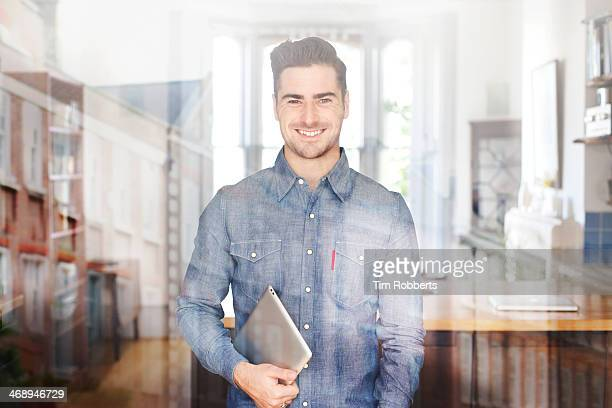 Man with digital tablet and reflections.