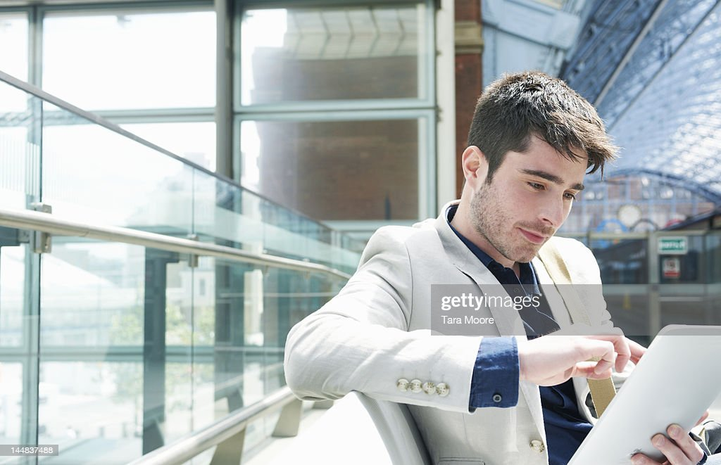 man with digital tablet at station : Stock Photo