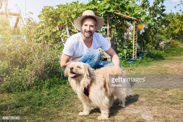 Man with dog in garden