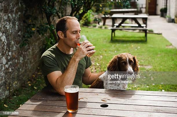 Man  with dog in pub garden