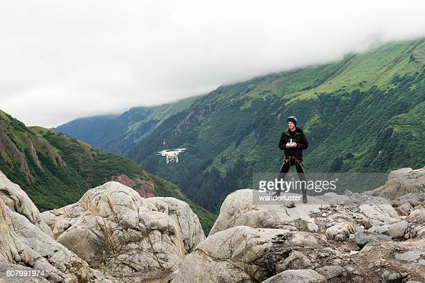 Man with drone at glacier