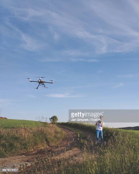 Man With Drone On Grassy Field