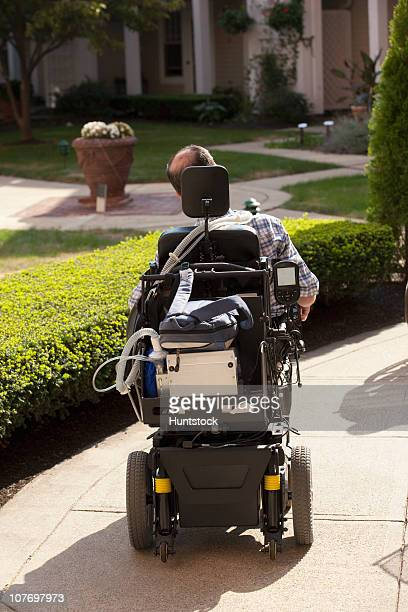 Man with Duchenne muscular dystrophy in a motorized wheelchair