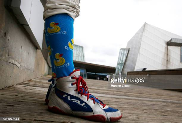 A man with duck socks stands on the Harbor Walk near the New England Aquarium in Boston on Aug 29 2017 An ongoing squabble between New England...