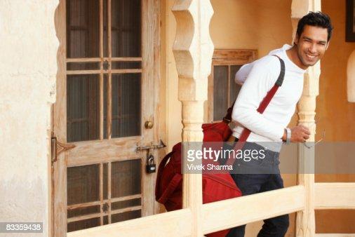 man with duffel bag