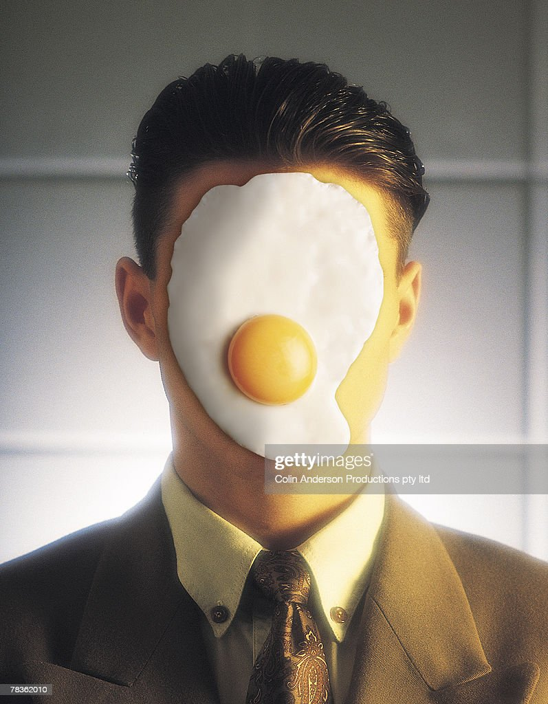 Man with egg on face : Stock Photo