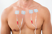 Close-up Of Man With Electrodes On His Chest