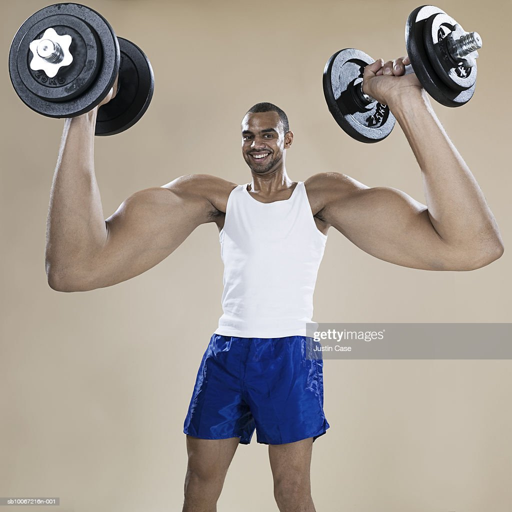 Man with enlarged arms lifting weights, portrait (Digital Composite) : Stock Photo