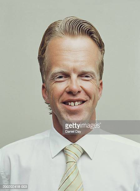 Man with enlarged forehead, smiling, portrait (Digital Enhancement)